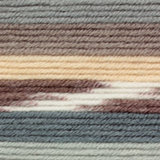Variegated yarn containing grey, brown, cream and white