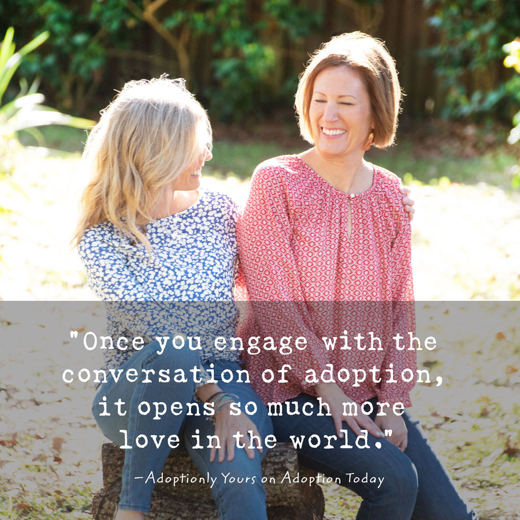 "Co-founders of Adoptionly Yours, Stacy and Jayne sit on a log in the sunshine talking and smiling. Quote overlaying the photograph reads: ""Once you engage with the conversation of adoption, it opens so much more love in the world."""