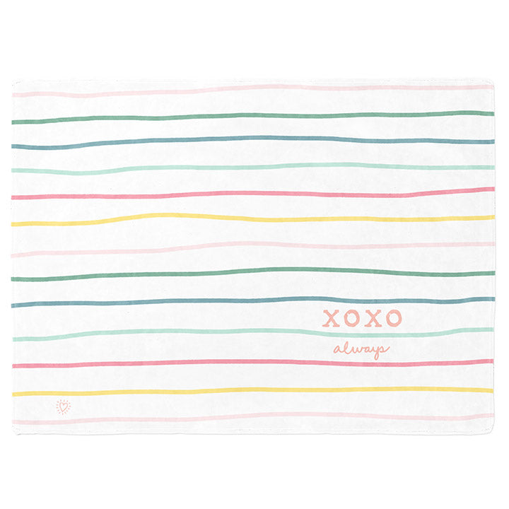 50 by 60 inch silky-soft fleece blanket that is hypoallergenic. Perfect size for an adult. Bright white blanket printed on one side only. 13 colorful hand drawn stripes of pink, green, blue, light teal, magenta and bright yellow run horizontally with the words xoxo, always in typewriter font. Adoptionly Yours heart logo by itself in pink in lower left corner of blanket on front.