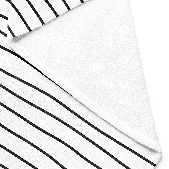 Backside of white 50 by 60 inch silky-soft fleece blanket that is hypoallergenic. Perfect size for an adult. Bright white blanket printed on one side only. 13 hand drawn black lines run horizontally across blanket. The words xoxo, always in mint green typewriter font on lower right side. A small Adoptionly Yours heart logo by itself in mint green in lower left corner of blanket on front.