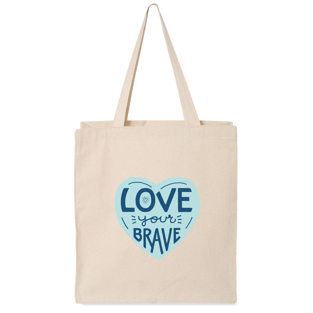 14.75 by 14.75 by 3.5 inch gusset 12 oz. 100% cotton canvas tote. Printed one side. Front side has 4 inch bright teal heart with words Love Your Brave in midnight blue.