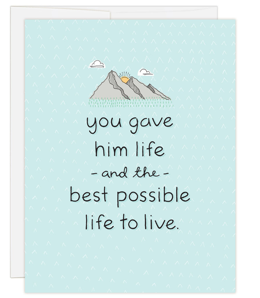 4.25 x 5.5 inch greeting card. Blank inside. Simple illustration style. Light Blue background with small mountain range illustration above title. Title You Gave Him Life and the Best Possible Life to Live.