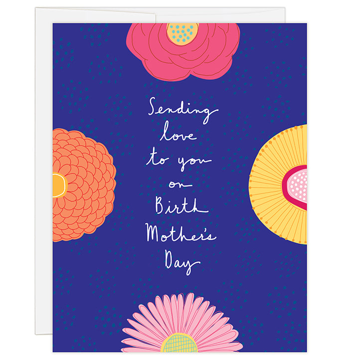 4.25 x 5.5 inch greeting card. Blank inside. Simple and charming illustration style. Title Sending love to you on birth mother's day. Title is white on royal blue background surrounded by 4 large colorful flowers that bleed off all 4 sides of the card.