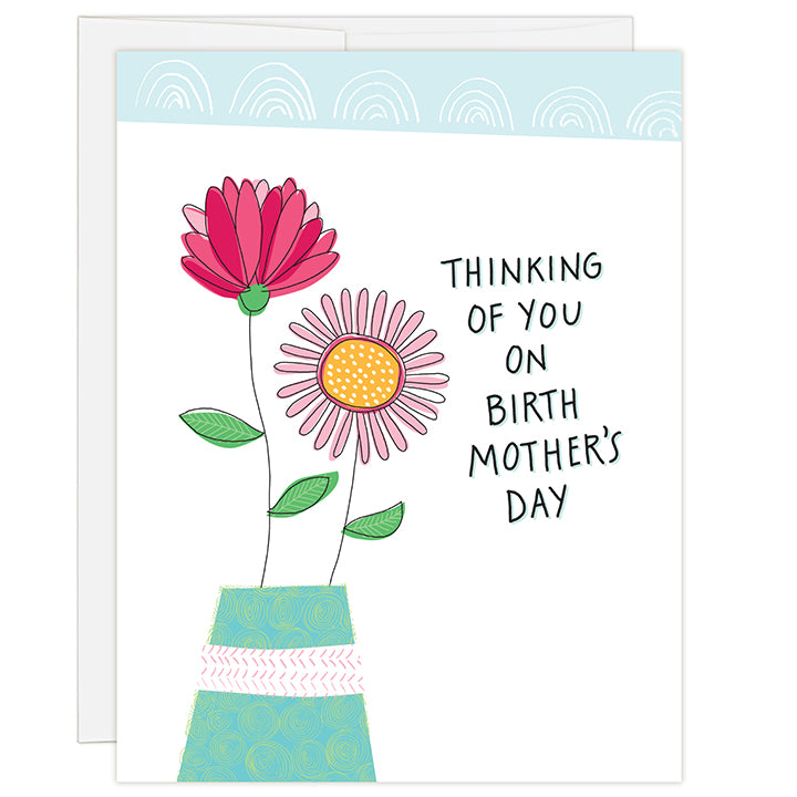 4.25 x 5.5 inch greeting card. Blank inside. Simple and charming illustration style. Title Thinking of you on birth mother's day. Drawing of a teal colored vase with two large flowers, one large pink and magenta and the other pink with a yellow center.