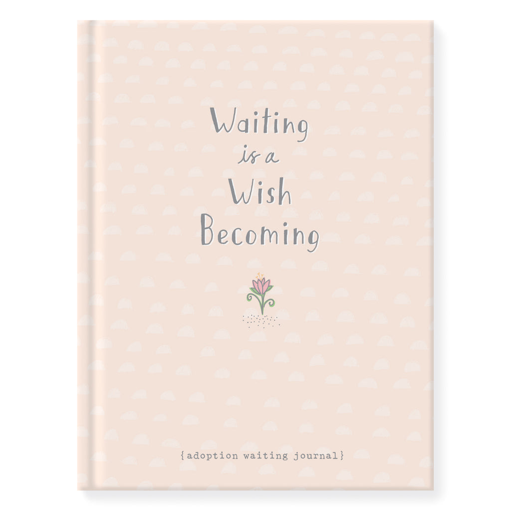 6.25 inch by 8.25 inch hardcover journal. 160 lined front and back pages. Acid-free paper. Simple and charming illustration style of a small hand drawn pink flower. Background is light peach with a hand drawn pattern of small half moons and wraps from the front to the back. Title on front cover Waiting is a Wish Becoming. Back of journal Adoptionly Yours heart logo.