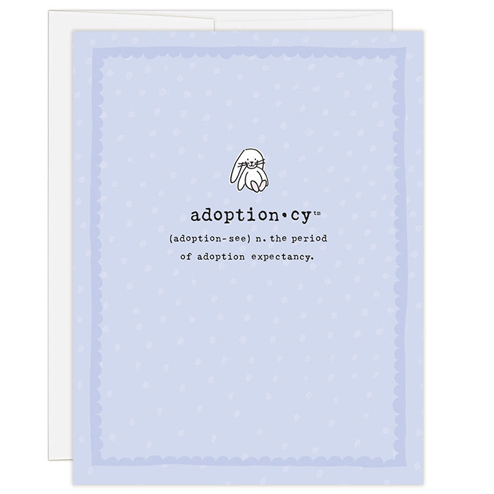 4.25 x 5.5 inch greeting card. Blank inside. Simple and charming illustration style. Title Adoptioncy (adoption-see) n. the period of adoption expectancy. Lavender background with light purple dots. Main image is a small white bunny rabbit.