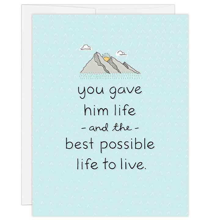 4.25 x 5.5 inch adoption greeting card for honoring a birth parent. Blank inside. Simple and charming illustration style. Light Blue background with small mountain range illustration above title. Title You Gave Him Life and the Best Possible Life to Live.