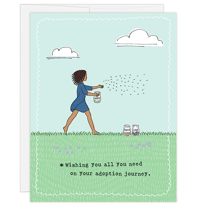 4.25 x 5.5 inch adoption encouragement greeting card. Blank inside. Simple and charming illustration style. Title *Wishing you all you need on your adoption journey. Main image is black woman spreading seeds from a jar with a label that says hope. Two more jars sit in front of her with labels that say faith and love.