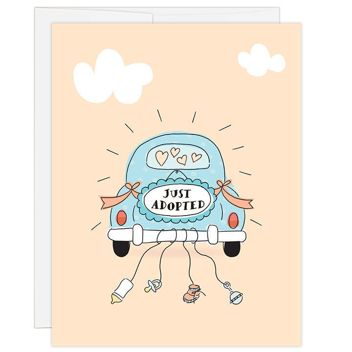 4.25 x 5.5 inch adoption greeting card. Blank inside. Simple and charming illustration style. Sign on back of a light blue antique car that reads JUST ADOPTED. Strings hang from the back bumper of the car with a baby bottle, pacifier, baby bootie and baby rattle.