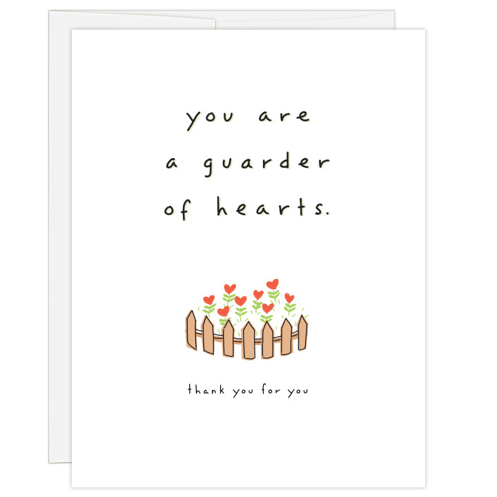 4.25 x 5.5 inch greeting card. Blank inside. White cover with small colorful illustration of a fence-lined heart garden. Text reads: you are a guarder of hearts. thank you for you.
