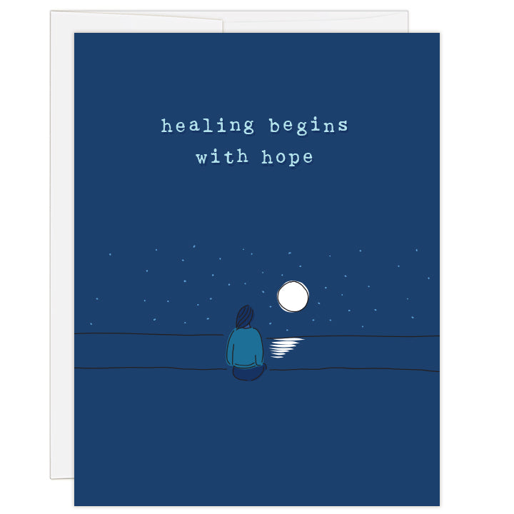 "4.25x5.5"" greeting card. Blank inside. Cover art woman seen from behind looking at bright moon. Title reads: healing beings with hope."