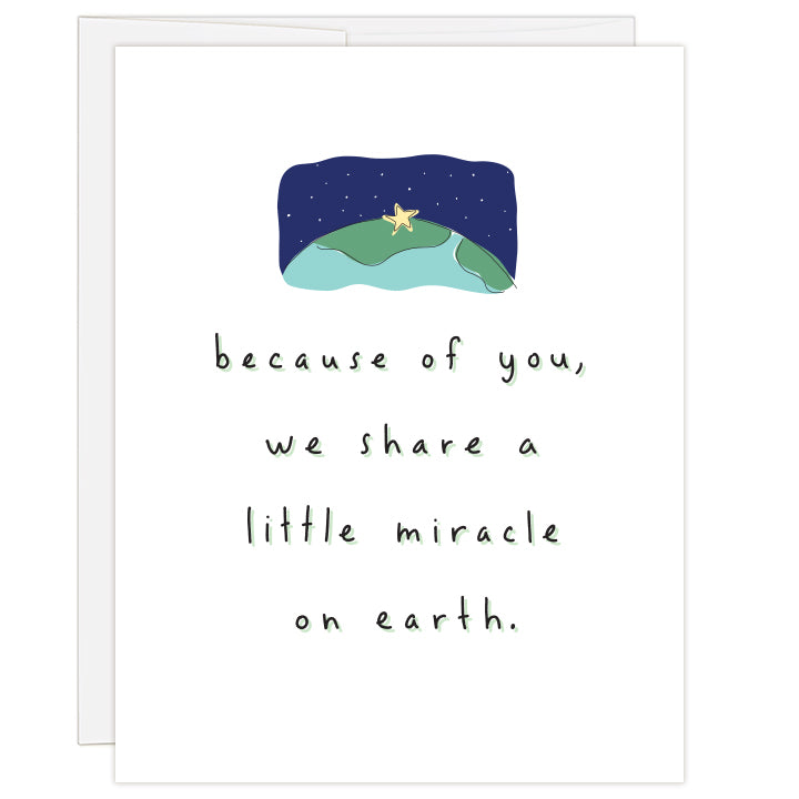 "4.25x5.5"" greeting card. Blank inside. Simple, charming illustration of star resting on earth beneath starry sky. Title reads because of you, we share a little miracle on earth."