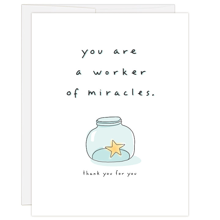 4.25 x 5.5 inch greeting card. Blank inside.  White cover with line illustration of a small blue-tinted jar holding a yellow star. Text: you are a worker of miracles. thank you for you