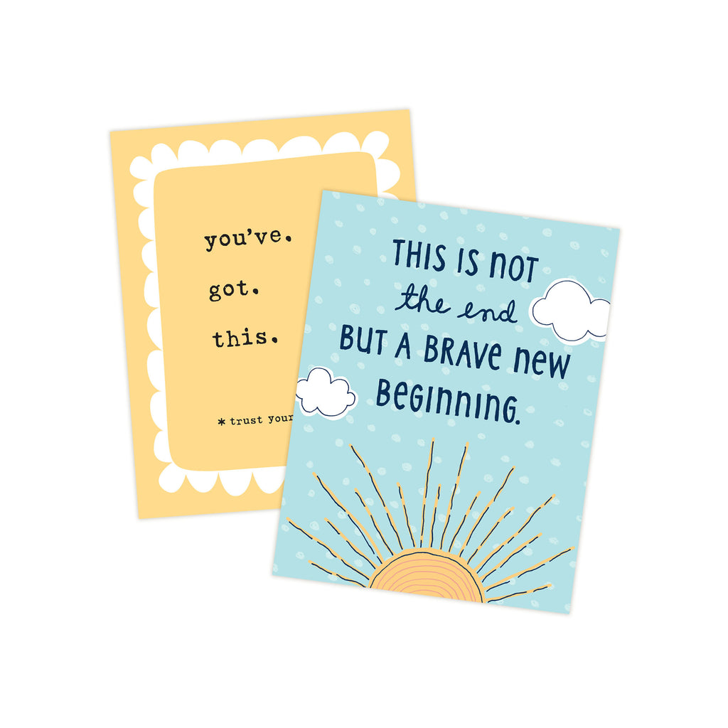 Two 4.25 x 5.5 inch greeting cards in a stack. Top card title reads This is not the end but a brave new beginning. Main image is an illustration of a yellow sunrise with white puffy clouds on sky blue background.