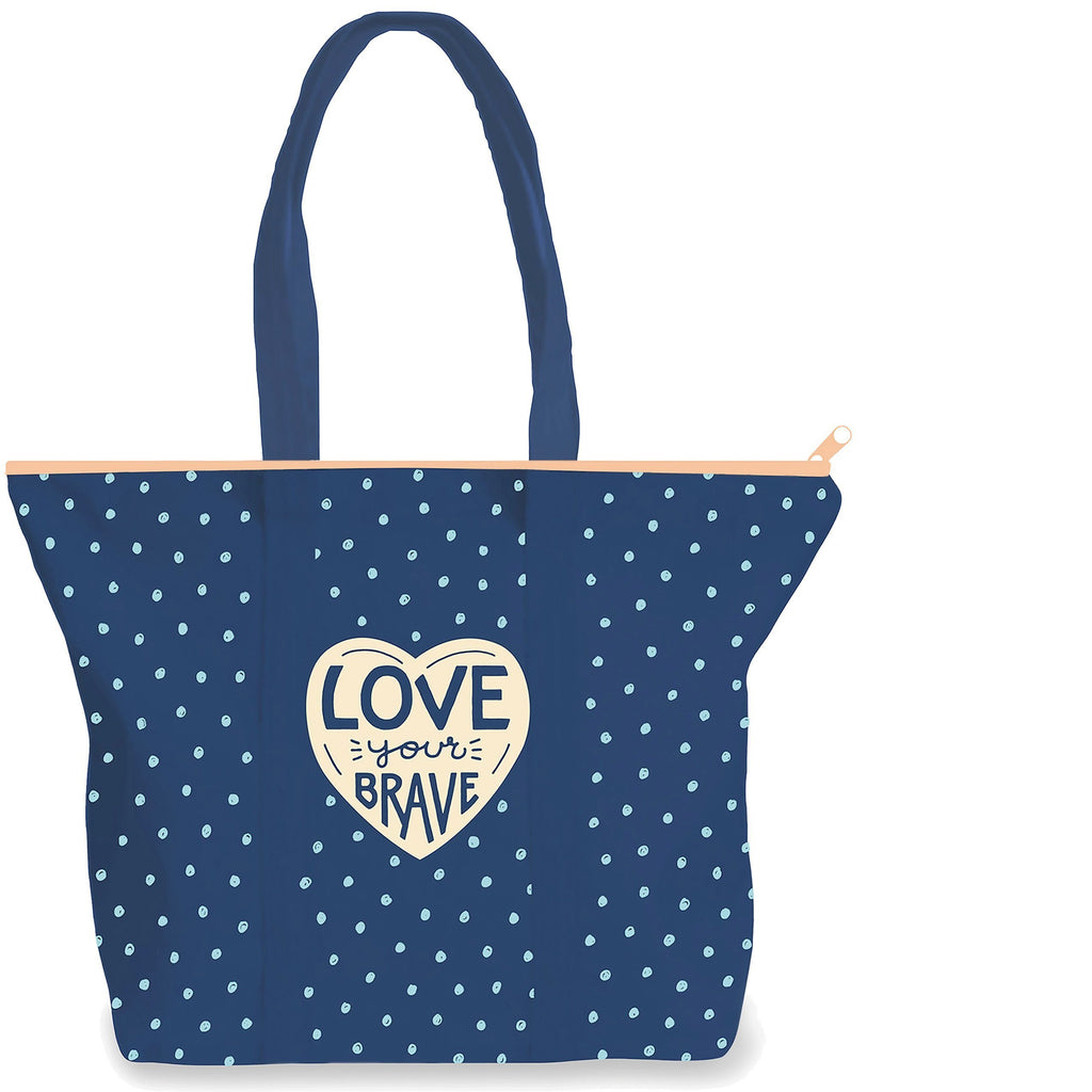 Front side of Midnight Blue 9 oz. canvas tote with a peach zipper. 17.5 by 15 by 5 inches. Small teal dots all over. Cream 4 inch heart centered with words Love Your Brave in midnight blue.