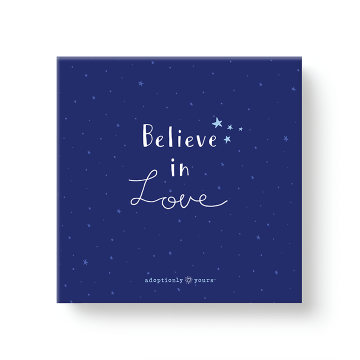 6 by 6 inch canvas wrap with 1.25 depth. Back of canvas with hard-sealed backing and hanging brackets. Simple and charming illustration style art wraps around the sides of frame. Title hand illustrated words Believe in Love in white and four light blue hand drawn stars above the word Believe. Background is a deep blue night sky with tiny light blue stars and wraps around the sides of the canvas. Small adoptionly yours words and logo below border of artwork.