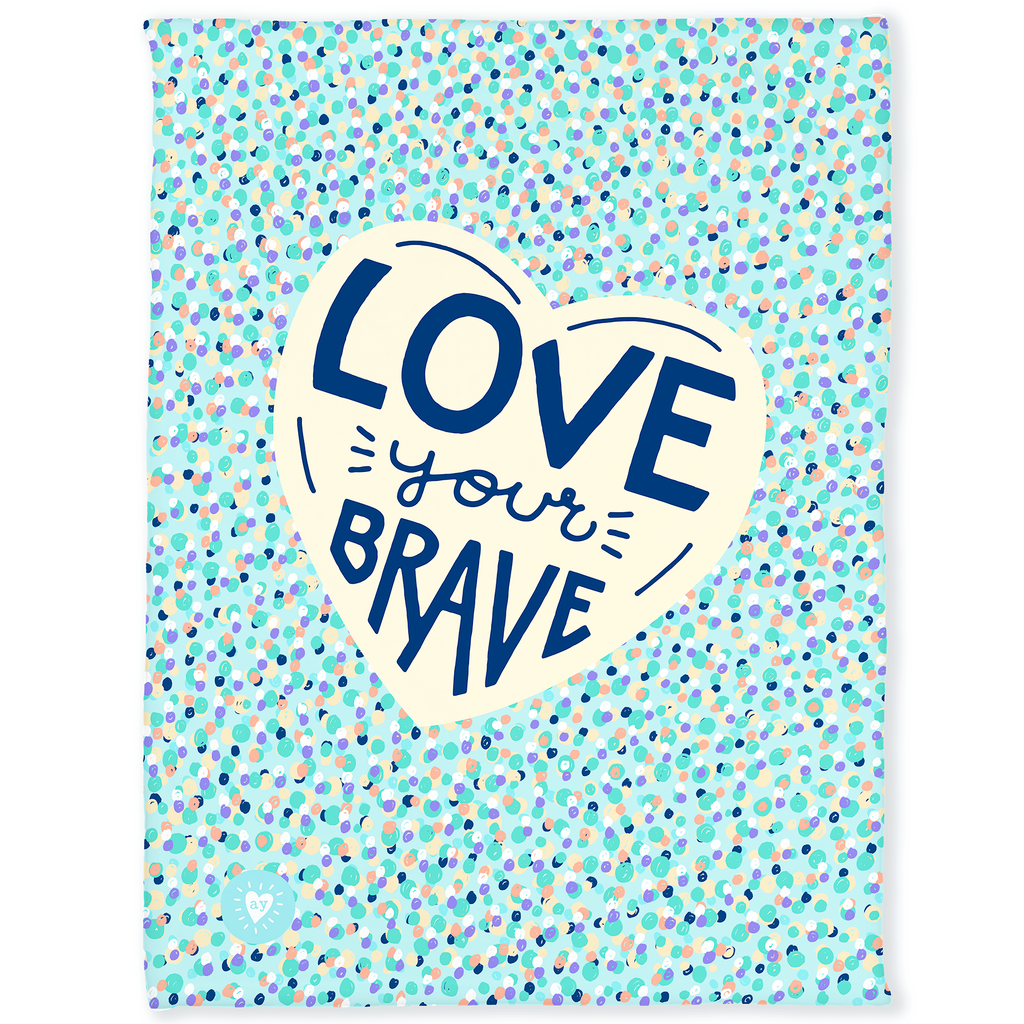 30 by 40 inch silky-soft fleece blanket that is hypoallergenic. Perfect size for a toddler or child. Bright white blanket printed on one side only. Colorful dot pattern on teal green background. In center of blanket is a large cream colored heart with the hand drawn words Love Your Brave in the center in dark blue. A small adoptionly yours heart logo is by itself on the lower left corner of the blanket.
