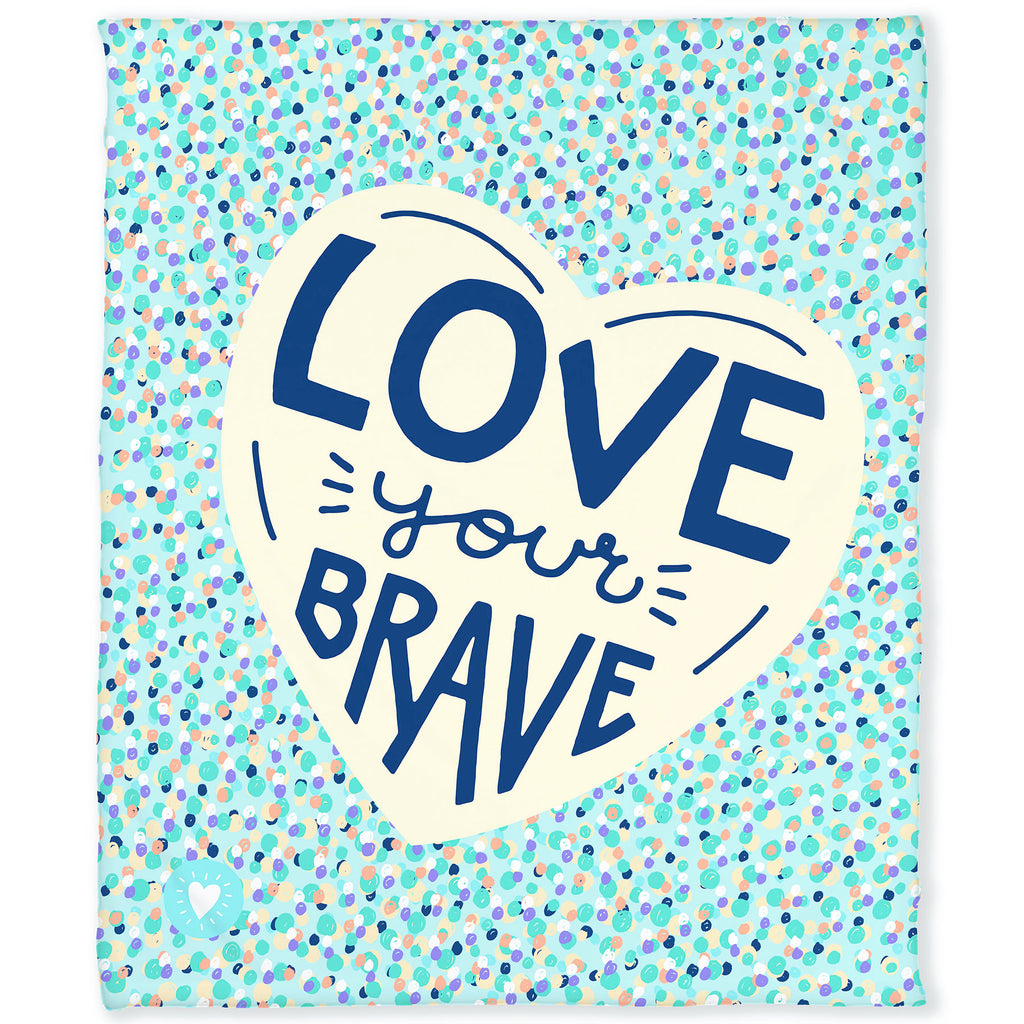 50 by 60 inch silky-soft fleece blanket that is hypoallergenic. Perfect size for an adult. Bright white blanket printed on one side only. Colorful dot pattern on teal green background. In center of blanket is a large cream colored heart with the hand drawn words Love Your Brave in the center in dark blue. A small adoptionly yours heart logo is by itself on the lower left corner of the blanket.