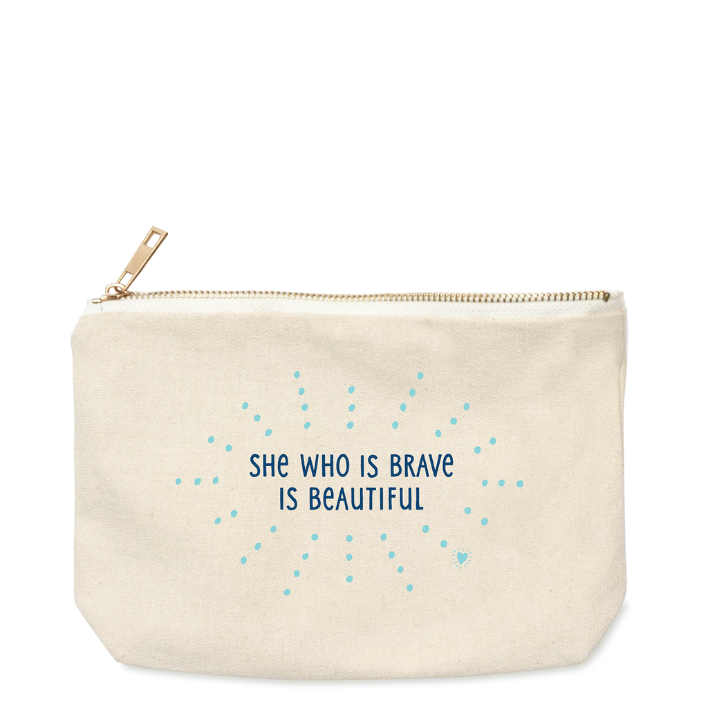 "9.75"" x 6"" x 1.75"" gusset 10 oz. 100% cotton canvas bag with gold zipper. Front has words She Who Is Brave Is Beautiful in midnight blue color and bright teal dots radiating from words. Back side is blank."