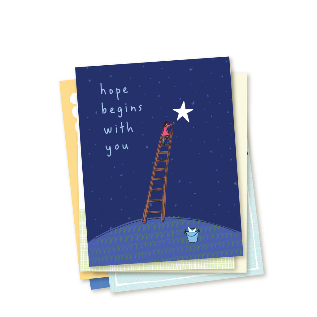 Stacked set of the cards in a six-card set of adoption encouragement greeting cards. Top card shows simple line drawing of a woman climbing a ladder to put a bright star up into a deep blue, star-filled sky. At the foot of the ladder waits a bucket holding another star. Card reads Hope Begins With You in hand-written text. Other cards in the set peek out beneath main card.