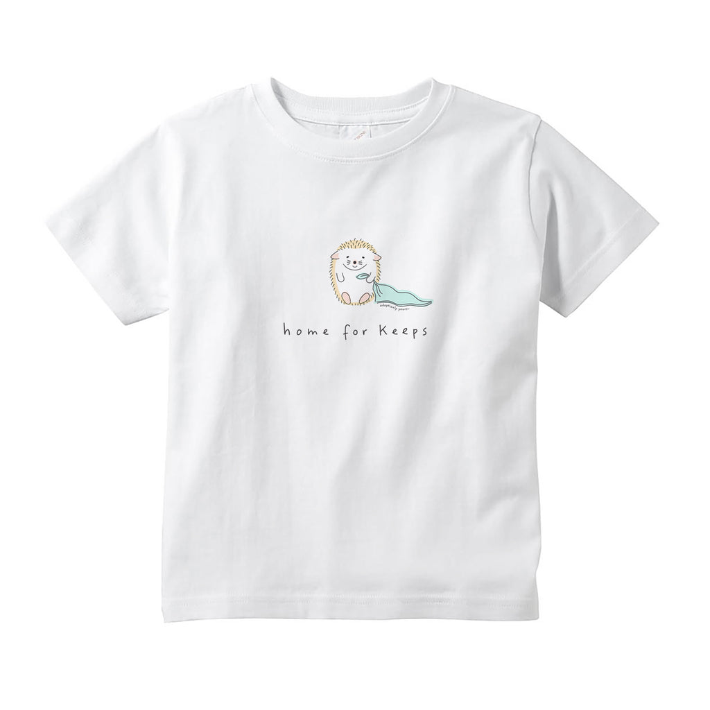 White 100% combed ringspun cotton toddler tee with tear-away label and topstitched rib collar. Small graphic in the center of the tee of simple and charming hand drawn hedgehog sitting and holding the corner of a mint green baby blanket. Below the hedgehog are hand drawn words in black that read home for keeps.