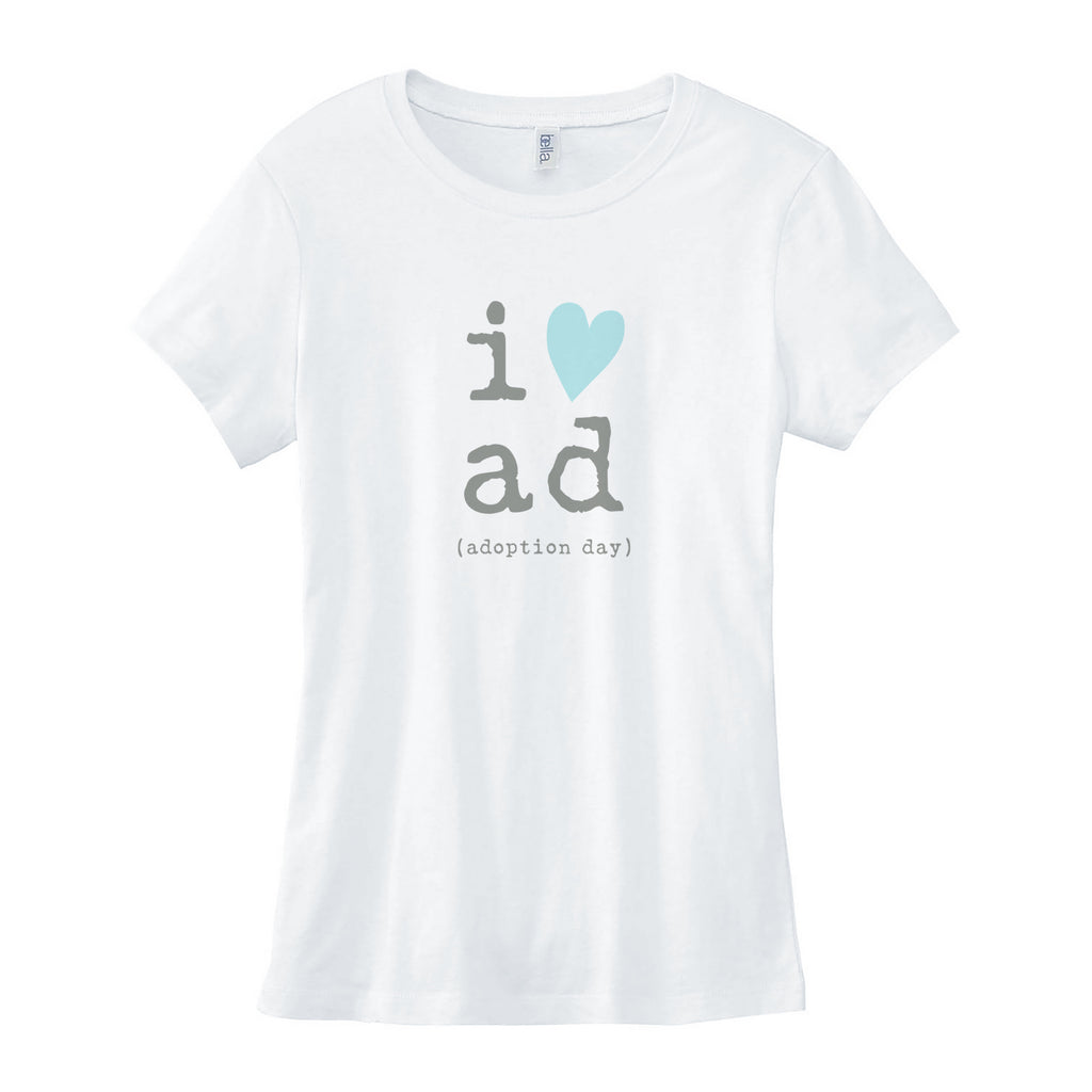 White 100% combed ringspun cotton slim fit crewneck tee. Longer length with cap sleeves. Graphic is in center of onesie in gray lowercase typewriter font with the letter i and a blue heart graphic. Stacked underneath are the letters a and d in gray typewriter font. Below a and d are the words in gray typewriter font and reads (adoption day).