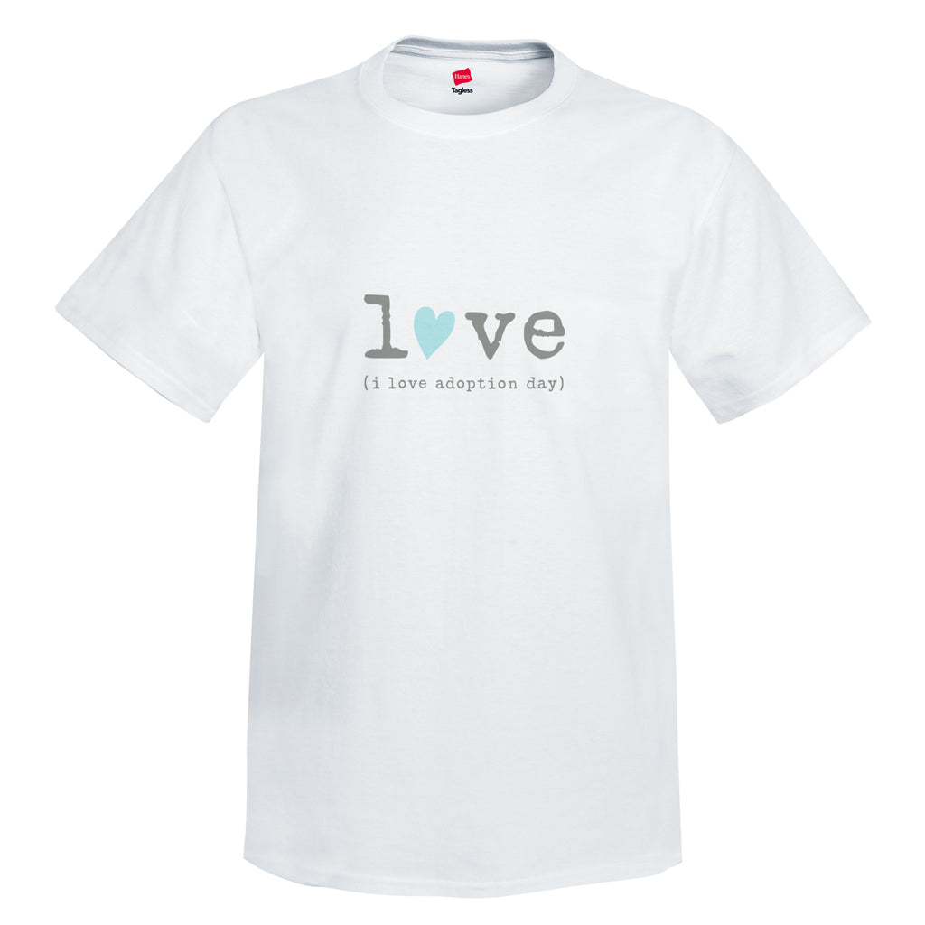 "White 100% cotton pre-shrunk tee. Crewneck unisex tee with and tag-less label. Graphic is in center of tee shirt in gray lowercase typewriter font spelling out the word love. The ""o"" in love is replaced with a hand drawn light teal blue heart tilted to the right. Below the word love is gray typewriter font and reads (i love adoption day)."