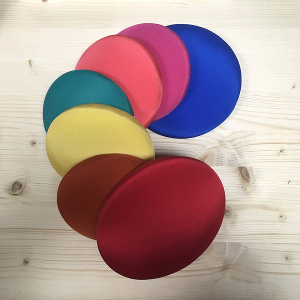 Ladies hats in multiple colours, including poppy red, lemon yellow, neon pink, electric blue & orange