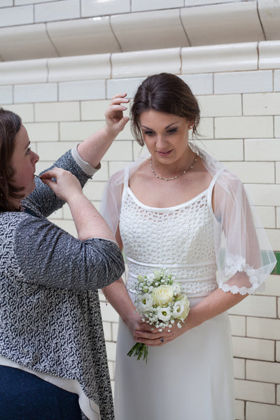 Pinning a bridal veil in place