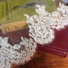 Wider corded scalloped lace edge of bridal veil