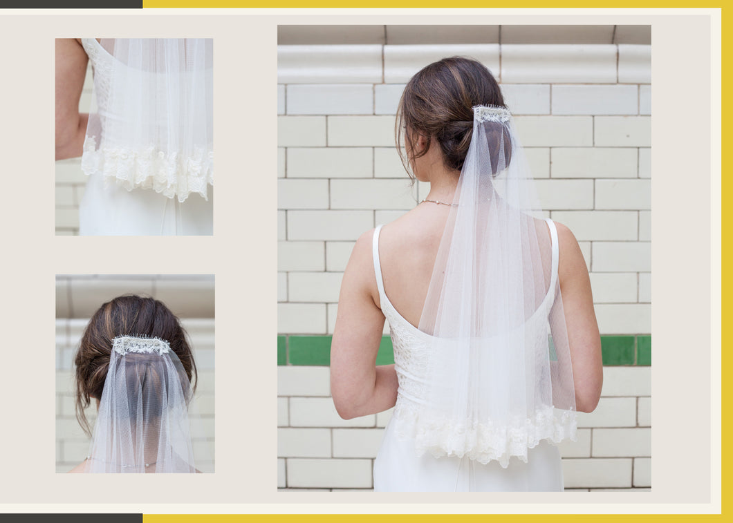 Short elbow length veil with lace edged tiers