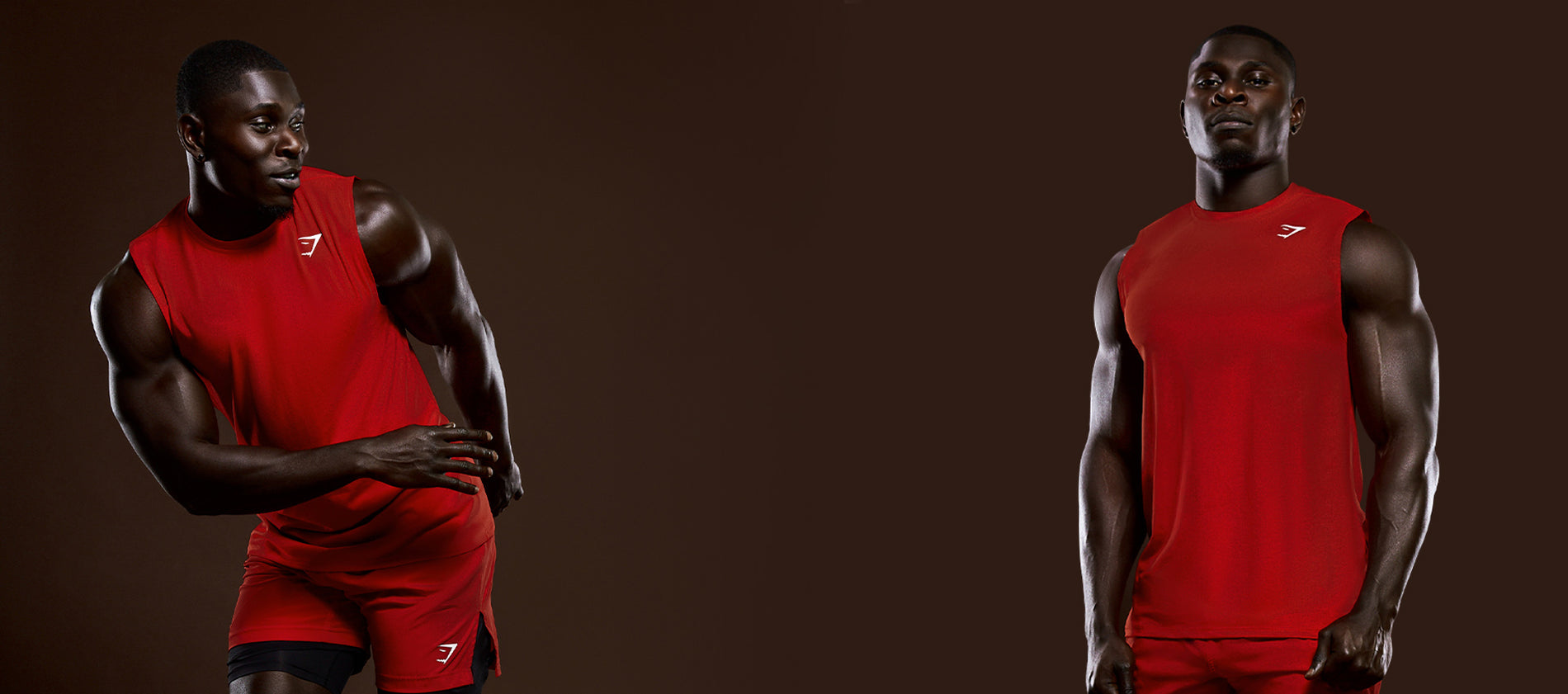 Gymshark Athlete George Bamfo posing in the Arrival tank and shorts in red.