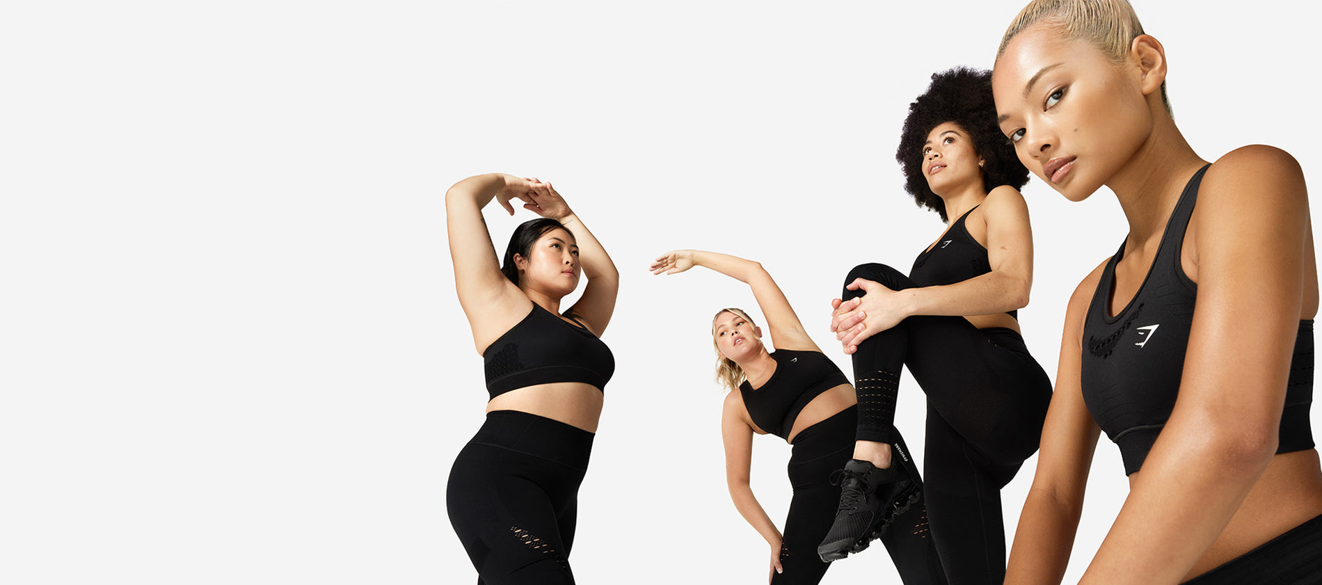 Models wearing the must-have Energy Seamless collection in black.