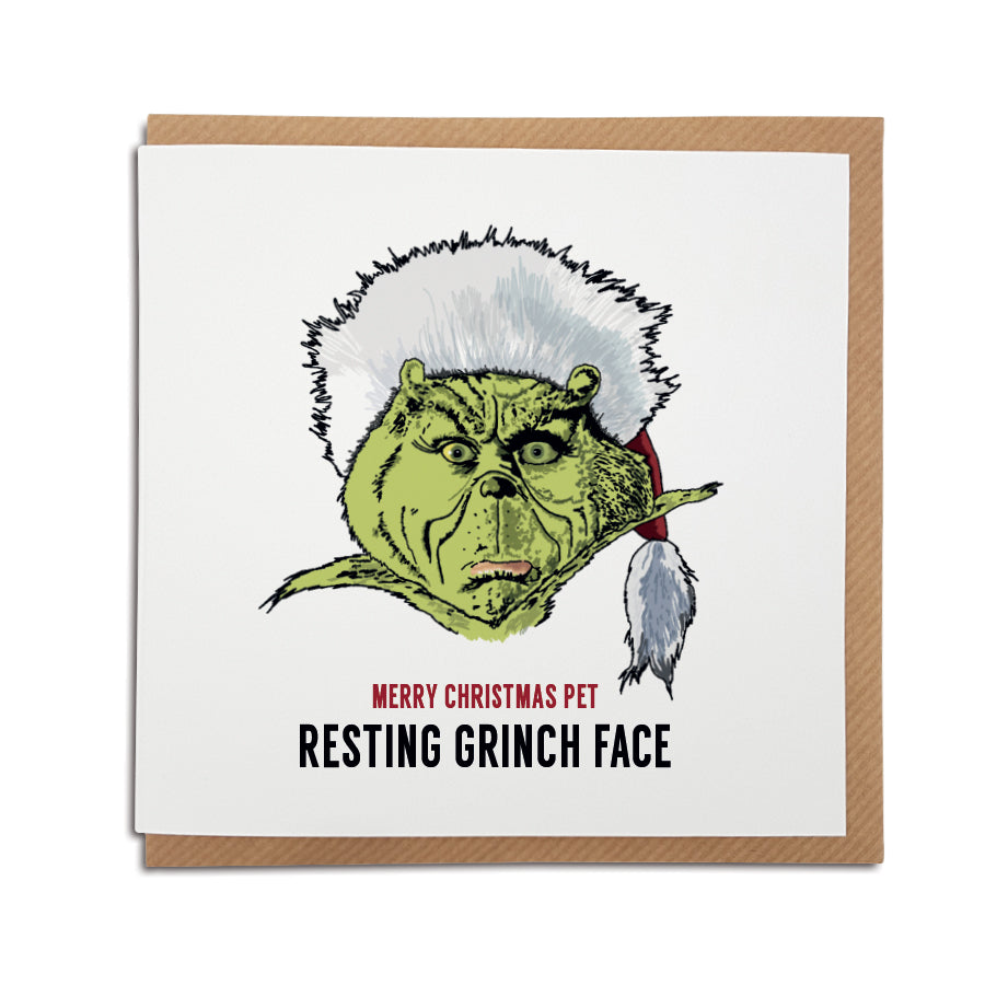 funny geordie gifts christmas card based on the film the grinch. Card reads: Merry Christmas Pet - Resting Grinch face (Illustration of the Grinch wearing a santa hat)