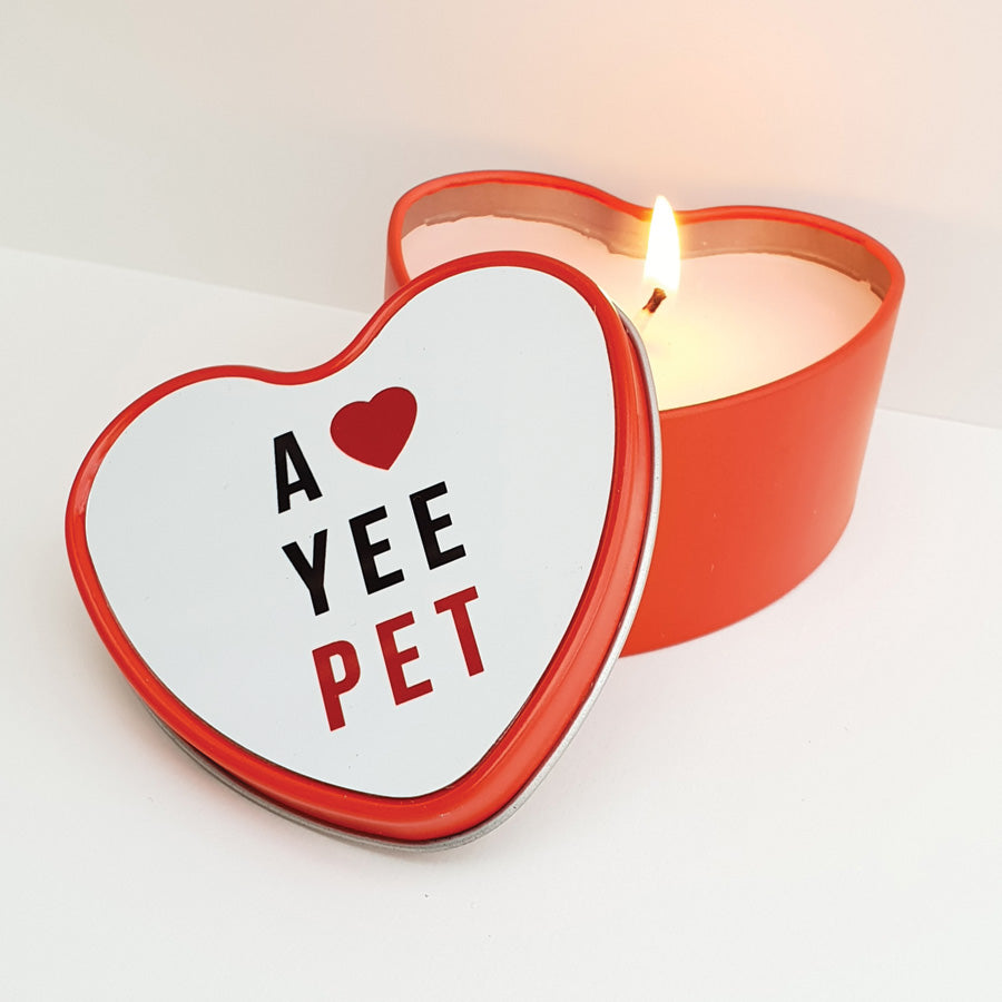 Funny & unique heart shaped metal tin contained a rose scented candle. Using the Newcastle & geordie dialect theme this has been designed & made by Geordie Gifts in the North East. Candle lid reads: a love yee pet. Perfect gift for valentines day or a present for your girlfriend or boyfriend