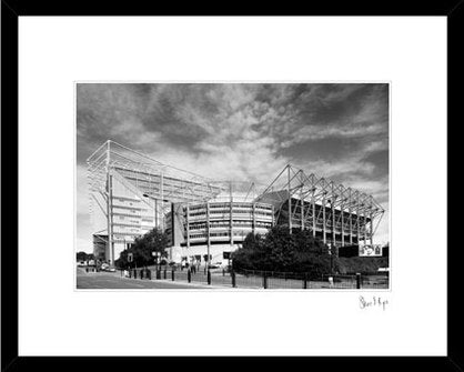 black & white image of St james park. Framed print by Geordie Gifts