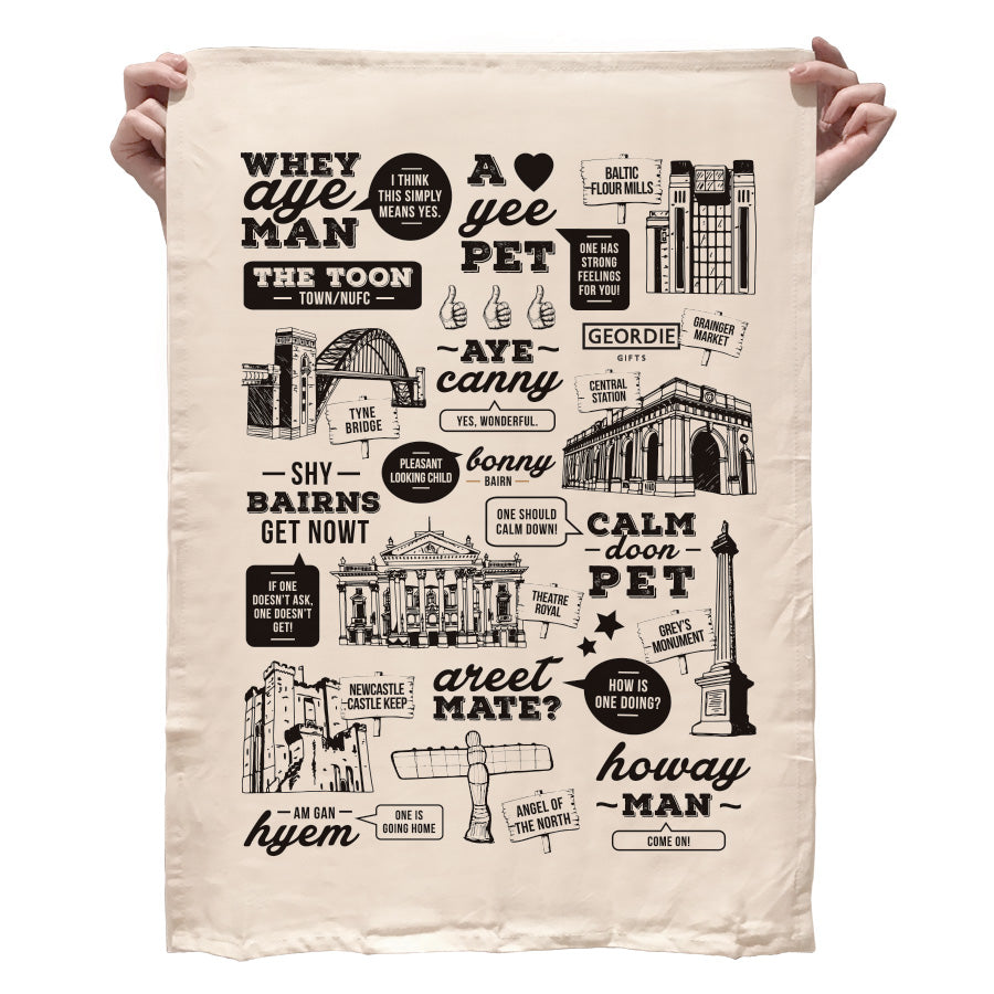 Geordie gifts Newcastle tea towel. Displaying Geordie phrases such as, whey aye man, shy bairns get nowt & illustrations of tyne bridge, angel of the north