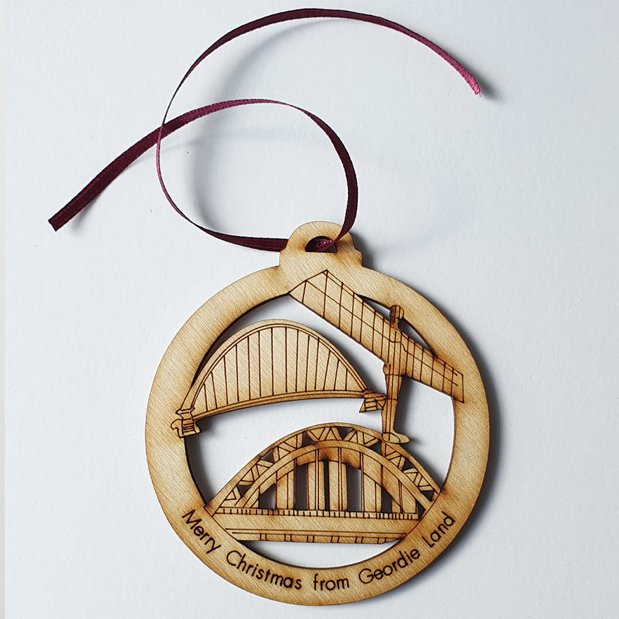 geordie christmas tree wooden bauble etched with tyne bridge, angel of the north & the millennium br