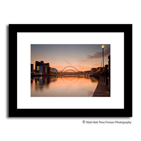 bright red skies over newcastle quayside in autumn. This framed print captures the Tyne Bridge looking up the river Tyne