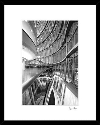 inside the sage Newcastle Gateshead photography looking out onto the river tyne. Tyne bridge black & white framed print. curved Glass architecture
