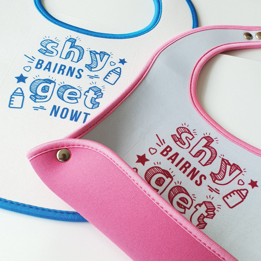 shy bairns get nowt geordie baby bib pink and blue matching with food & crumb catchers. easy wipe newcastle gifts