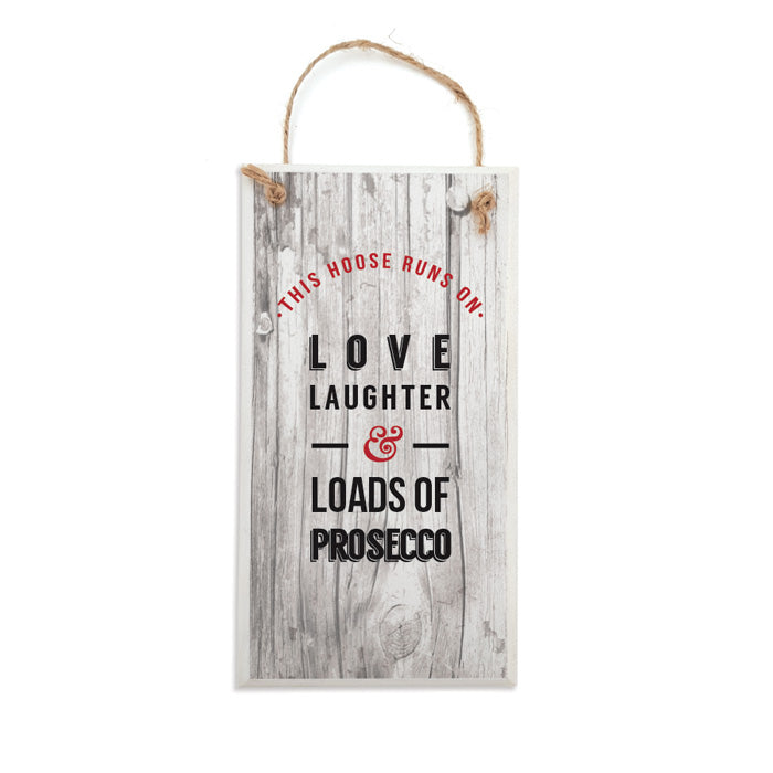 Funny geordie gifts plaque sign. Reads: This hoose runs on lovem laughter & loads of prosecco.