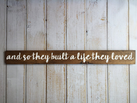 and so they built a life they loved - hand painted sign