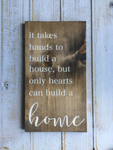 It takes hands to build a house, but only hearts can build a home - Hand Painted Typography Sign