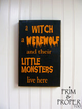 A Witch A Werewolf and Their Little Monsters Live Here Hand Painted Typography Sign