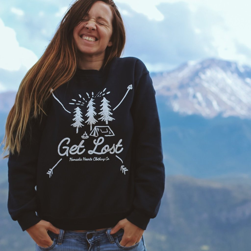 nomadic hearts clothing co. get lost crewneck sweatshirt with pine trees and camping scene