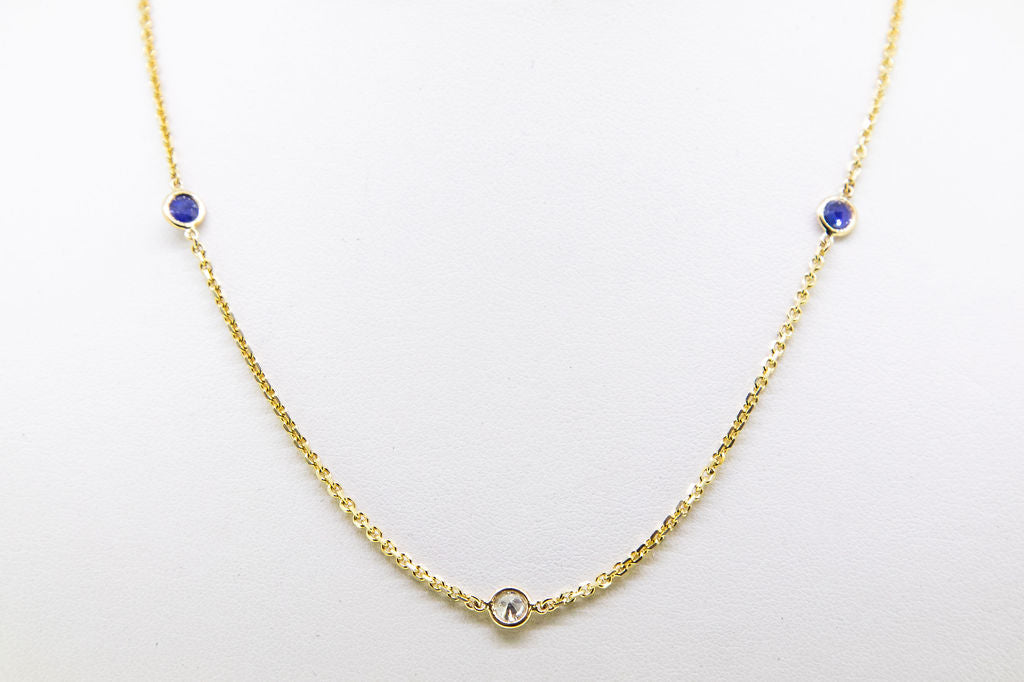 14 K YG Diamond and Sapphire by the yard chain Jewelry Store downtown boston