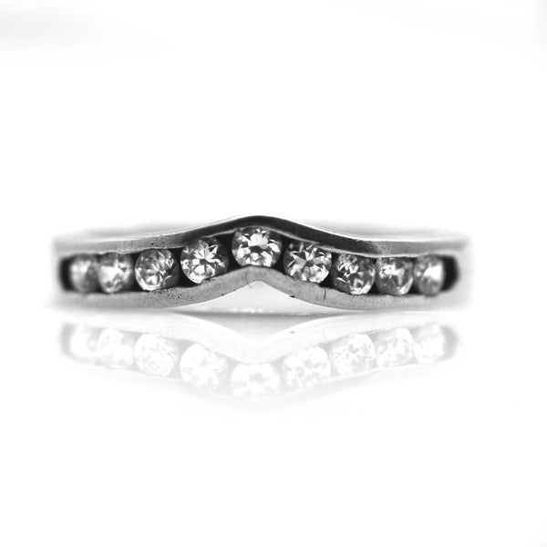GoldQuest Jewelers in Boston channel set curved wedding band