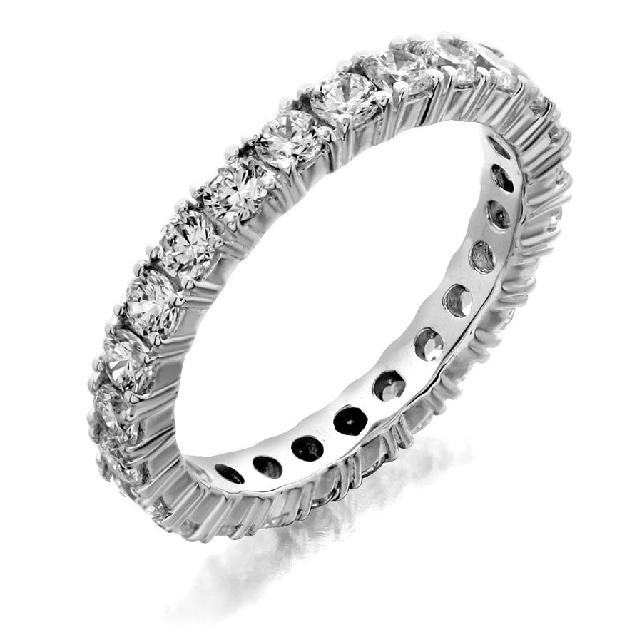 Eternity wedding band with four prong from GoldQuestJewelers jewelry store in Boston