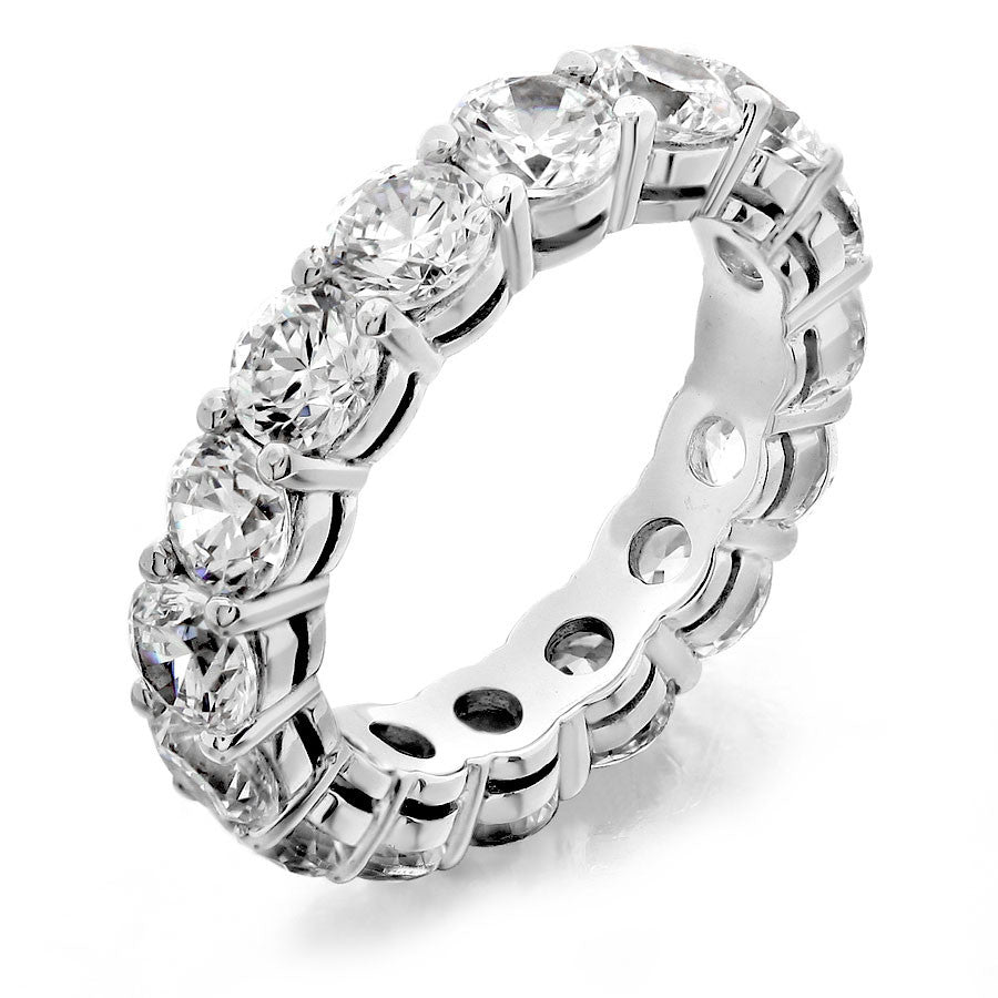 Eternity wedding band with shared prong from GoldQuestJewelers jewelry store in Boston